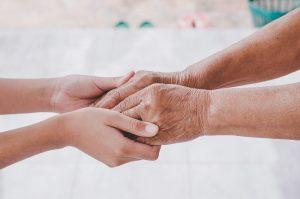 holding hands of elderly