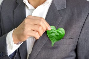 holding heart shaped leaf